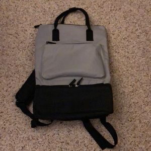 Backpack bag with bottom shoe section